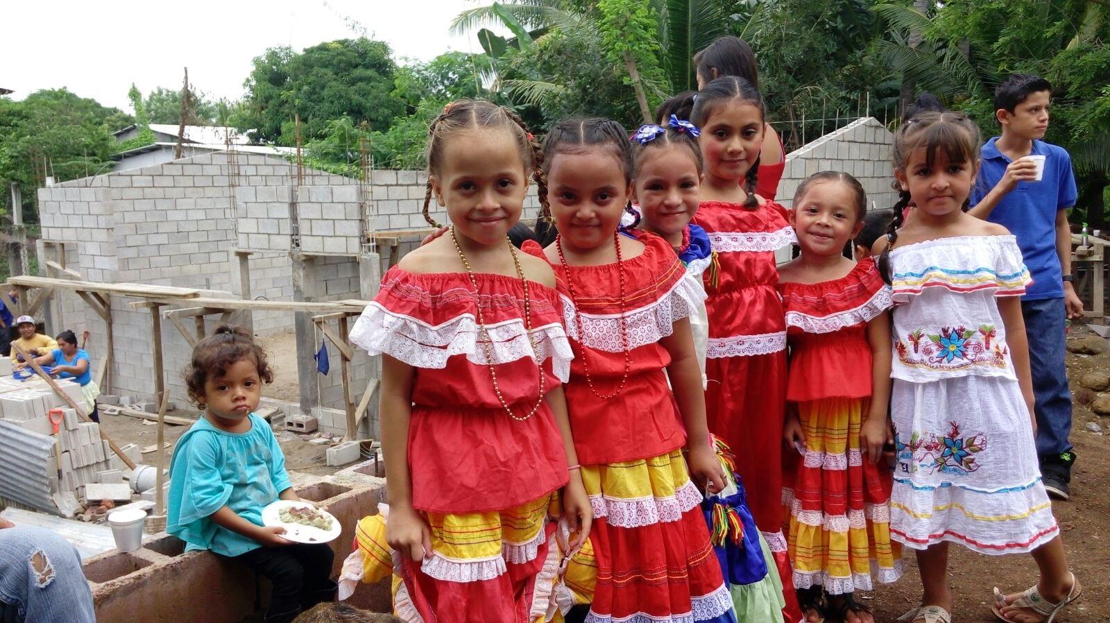 Children in front of school construction