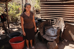 Erika before an eco-stove