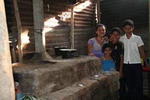 Erika and family with eco-stove