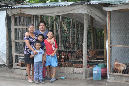 Family with chickens