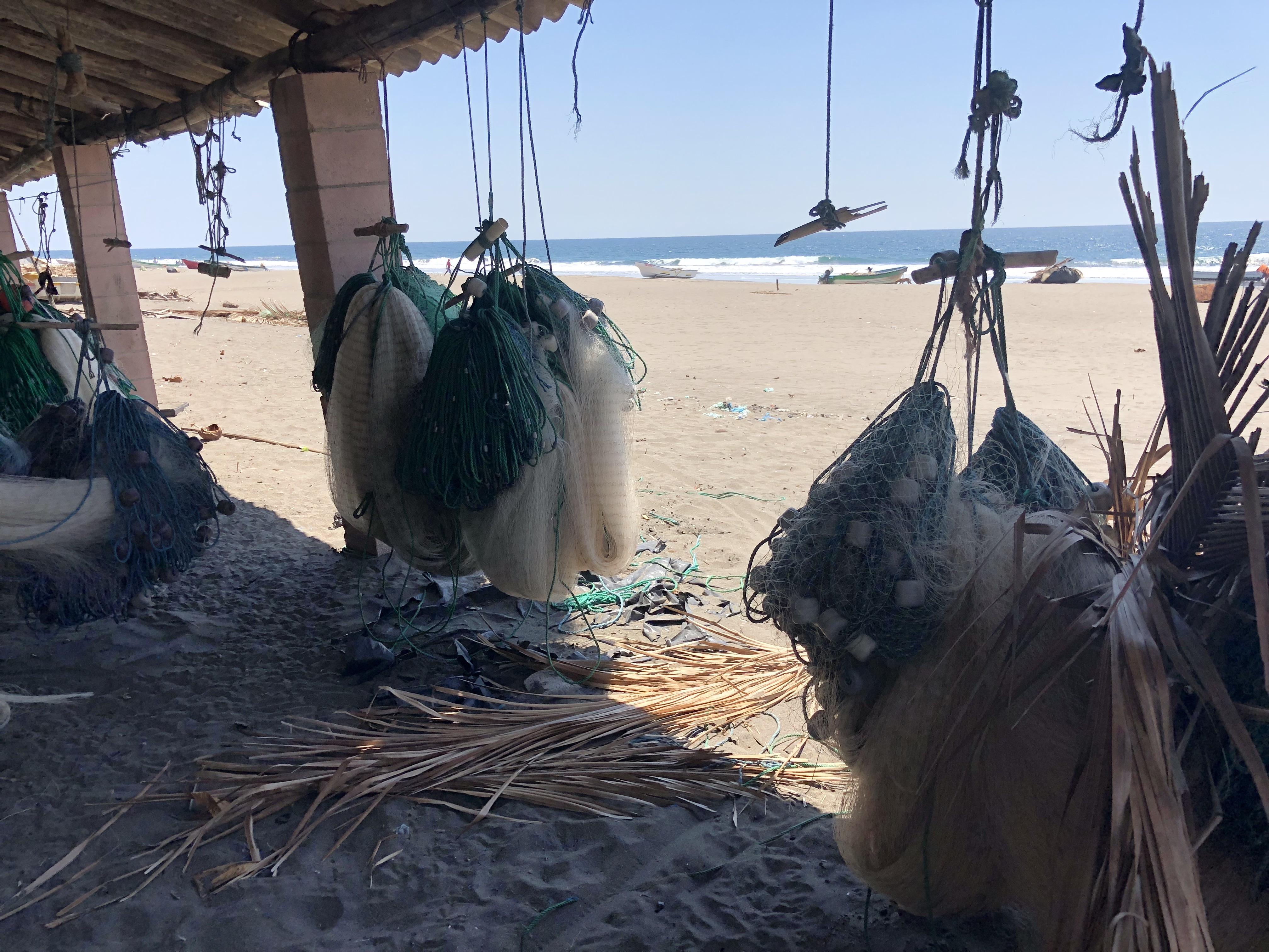 Hanging Fishing Nets on the Beach in Metalio